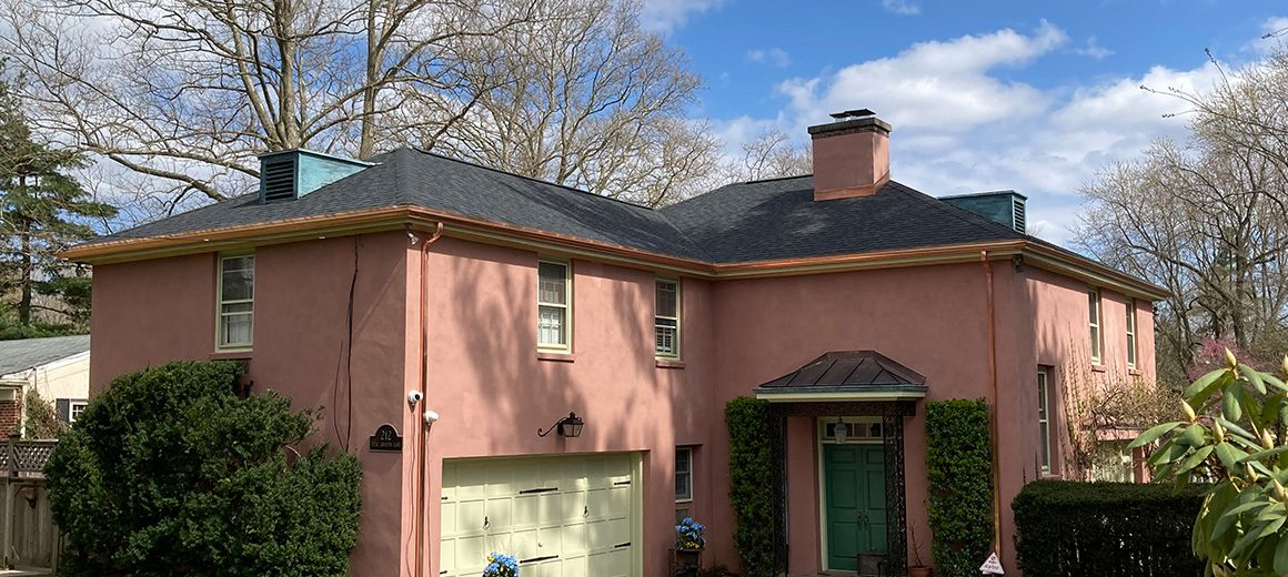 roof with certainteed shingles with copper gutters